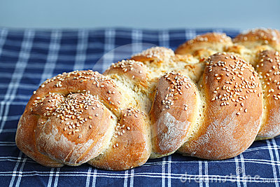 Artisan braided loaf with sesame seeds