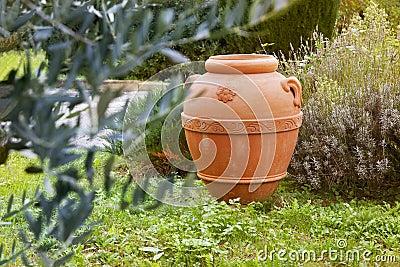 An artisan ceramic container in the garden