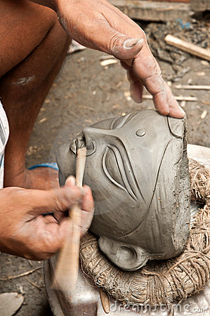 Artisan creating clay head