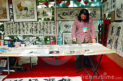 Artist on art exhibition Editorial Stock Image
