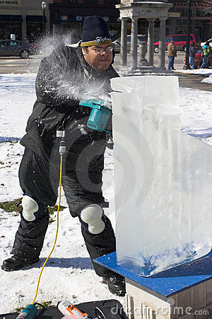 An artist carving a block of ice Editorial Stock Image