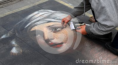 An artist painting a portrait of a girl Editorial Stock Photo