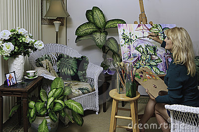 Artist in her fifties painting