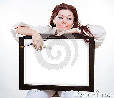 Artist holds empty frame