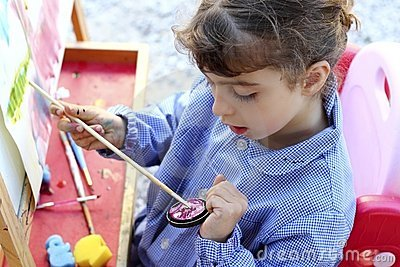 Artist little girl painting watercolors portrait