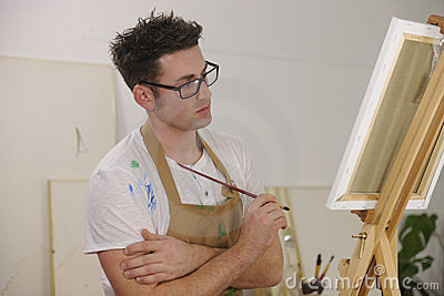Artist painting model at art studio
