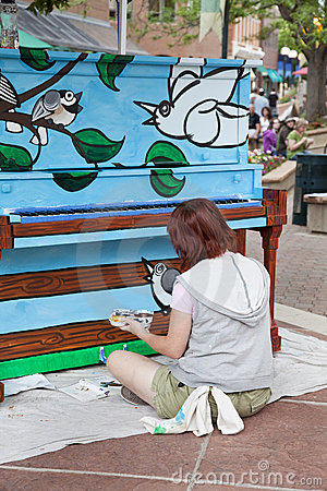 Artist painting mural on the piano Editorial Stock Photo