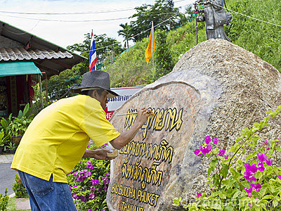 Artist painting sign at Big Buddha Statue site. Editorial Stock Image