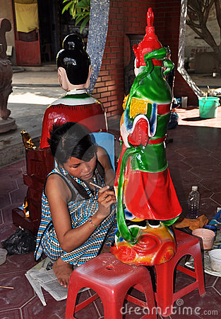 Artist Painting Statue at Floating Temple, Vietnam Editorial Stock Image