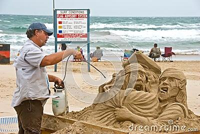 Artist works on beach