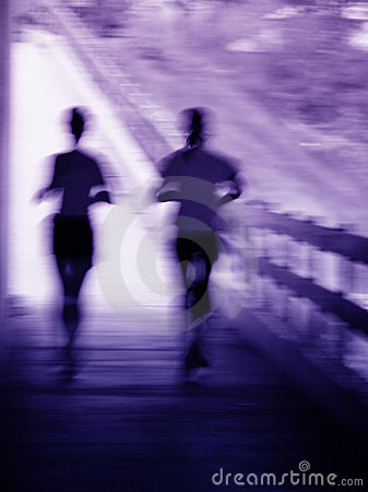 Artistic blur of a running couple