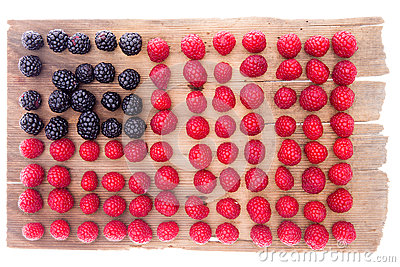 Artistic display of raspberries and blackberries