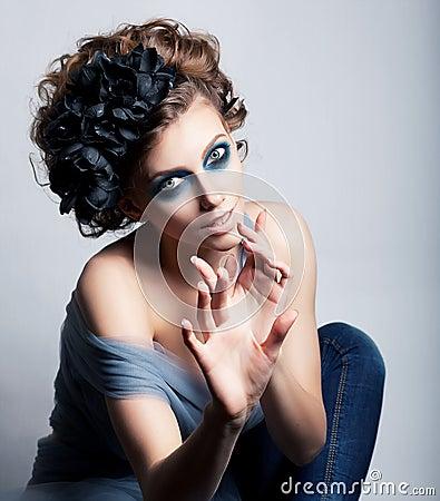 Artistic female posing - bright blue makeup
