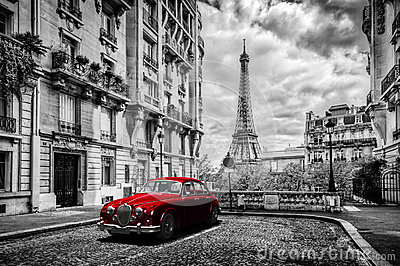 Artistic Paris, France. Eiffel Tower seen from the street with red retro limousine car. Stock Photo