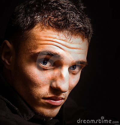 Artistic portrait of man with beautiful eyes