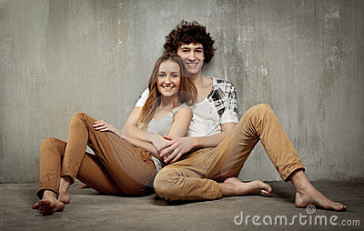 Artistic portrait of a young couple on a gray