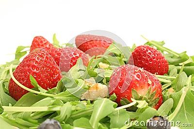 Arugula salad w/berries & nuts upclose