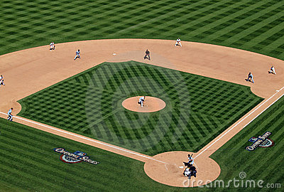 As pitcher throws a pitch with bases loaded Editorial Image