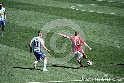 Francesco Totti kick a ball during a match Editorial Photo
