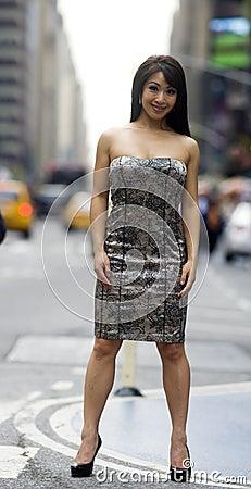 Asain Woman Sexy Pose on Crowded City Street