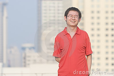 Asain young man smiles