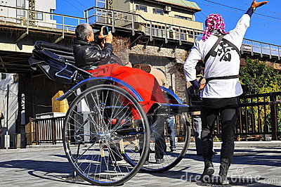 Asakusa rickshaw with a tourist and the puller Editorial Stock Photo