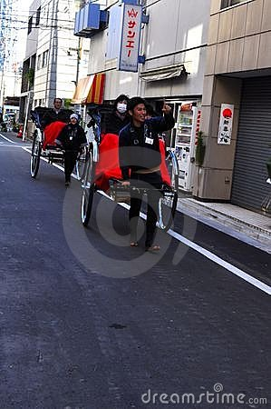 Asakusa rickshaw with a tourist and the puller Editorial Stock Image