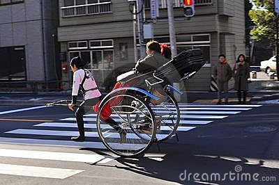 Asakusa rickshaw with a tourist and the puller Editorial Photography