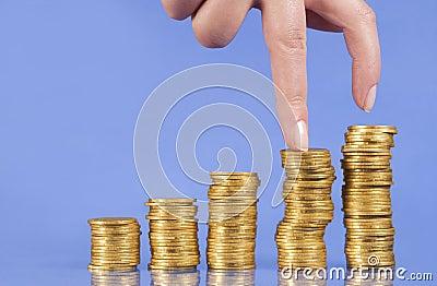 Ascende delle monete dorate
