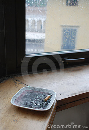 Free Ashtray On Cold Window Ledge Stock Images - 8767474