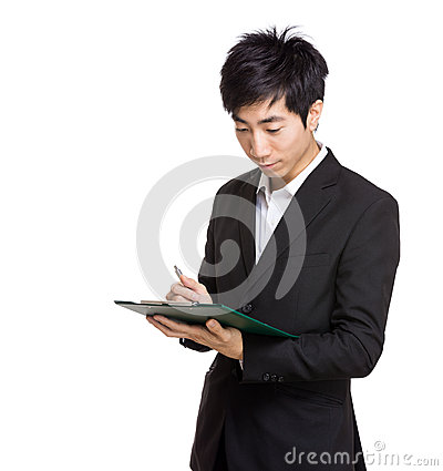 Asia businessman writing on file pad