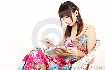 Asia girl reading magazine