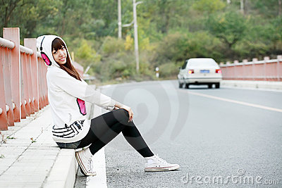 Asia girl sitting roadside
