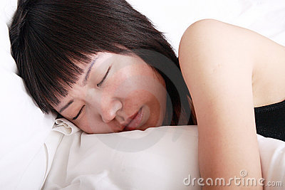 Asia girl sleeping on bed