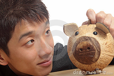 Asia man with piggy bank