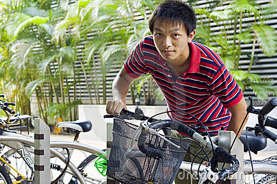 Asia man take bike in bicyle park Editorial Photo
