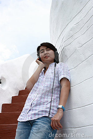 Asia woman listening to music on headphones