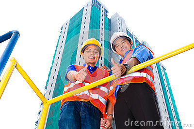 Asian architect and supervisor on construction site