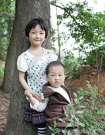 Asian baby boy with his elder sister