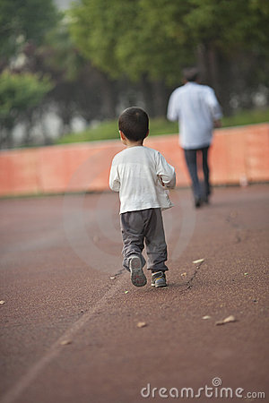 Asian baby boy running  following his grandpa