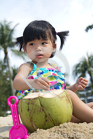 Asian baby girl on beach