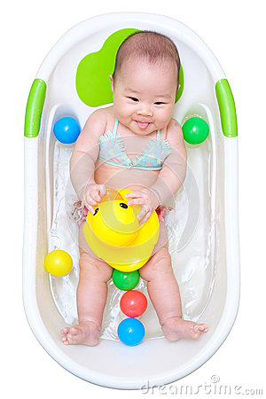 asian baby girl taking a bath in white tub and playing duck stock photo ima. Black Bedroom Furniture Sets. Home Design Ideas