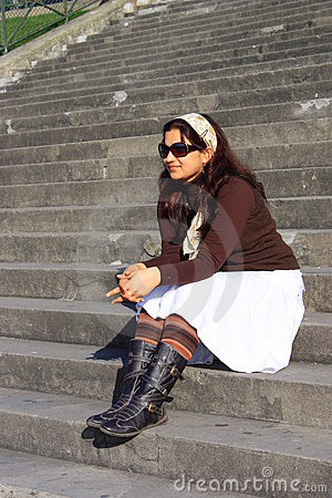 An asian beautiful Girl sitting on stairs