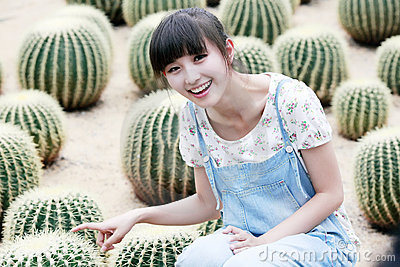 Asian beauty in cactus field