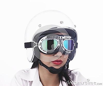 Asian biker girl wearing a helmet