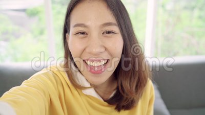 Asian blogger woman using smartphone recording vlog video in living room at home,female enjoy funny moment. Asian blogger woman using smartphone recording vlog stock footage