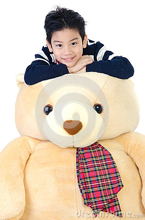 Asian boy with big bear doll
