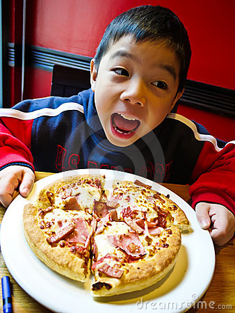 Free Asian Boy Eating Pizza Stock Photos - 20914673