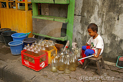 Asian boy with empty petrol bottles Editorial Image