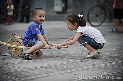 Asian boy and girl happy playing outside